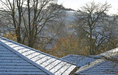 Snow on Roof Tops by David Packman